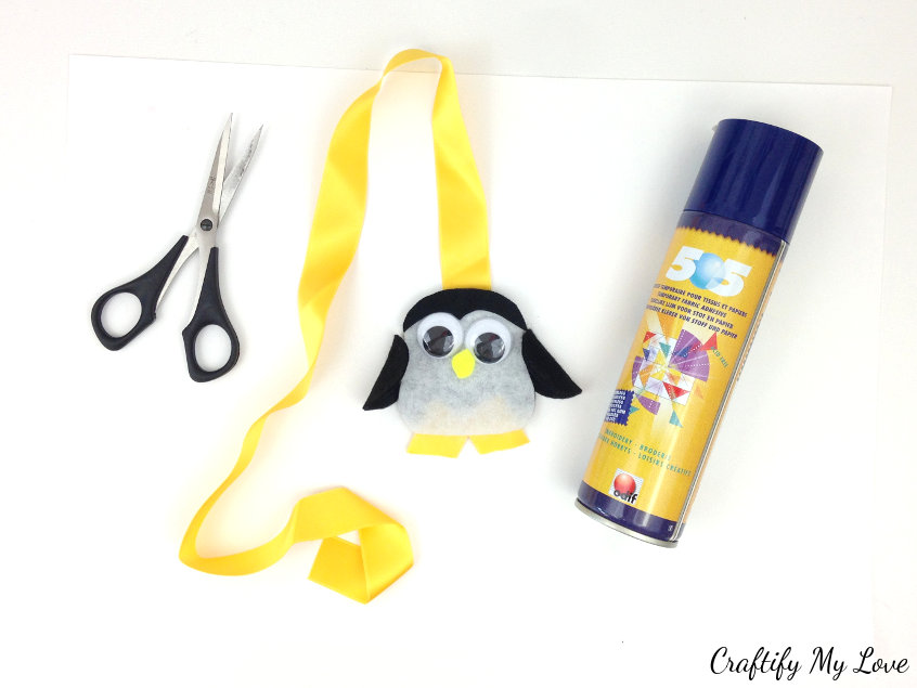 set your individual elements of this kids craft penguin felt bookmark together as preparation for assembly