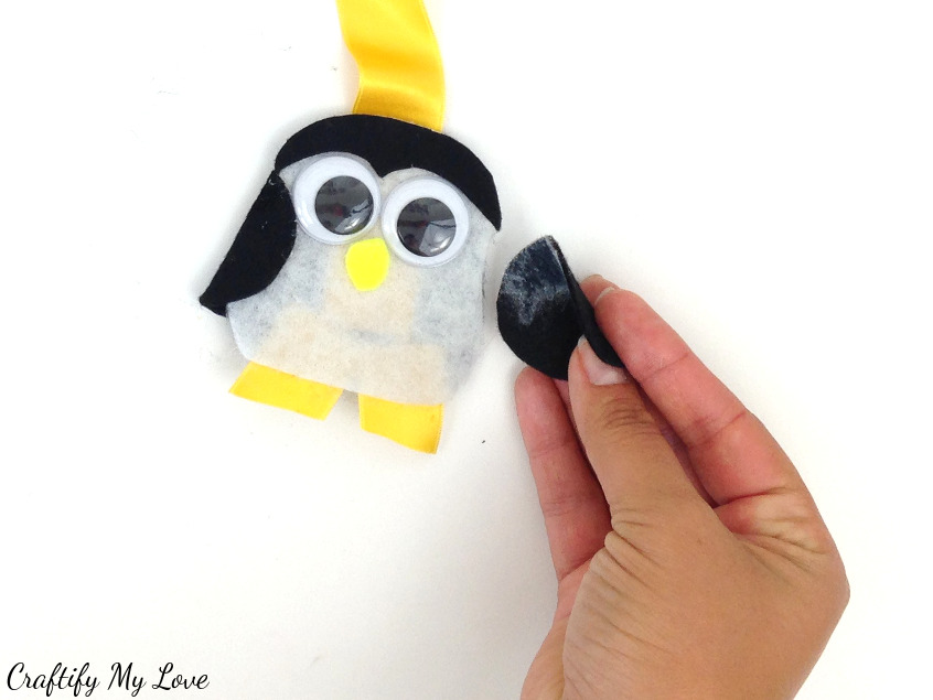 using spray adhesive glue the felt circle wing to your layering penguin owl bookmark