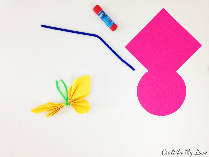 wrap the pipe cleaner around your accordion or fan fold butterfly spread the wings