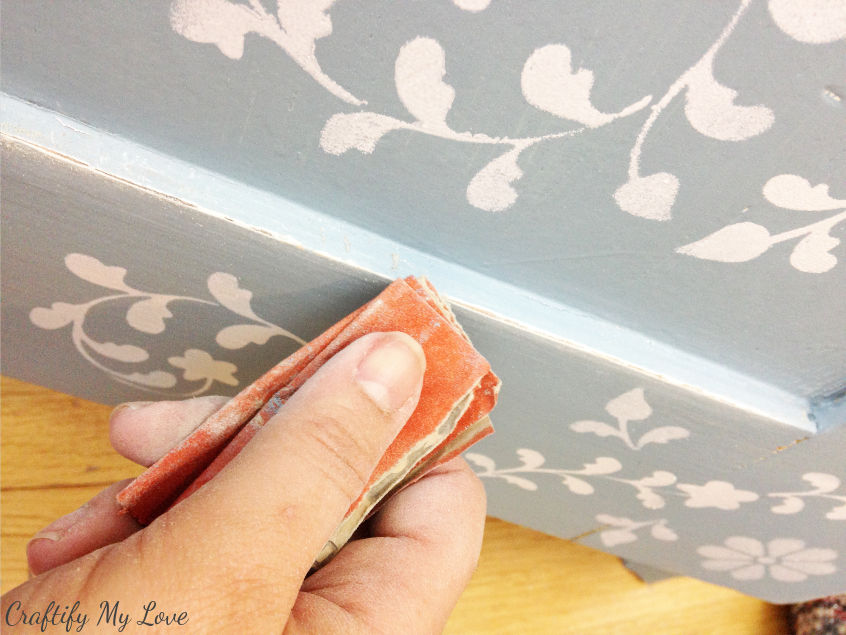 using sanding paper lightly distress your anthropologie dresser knock-off or look alike cabinet