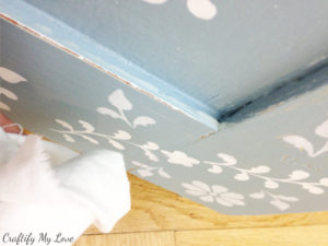 Wipe away excess furniture wax from your transformed second hand dresser