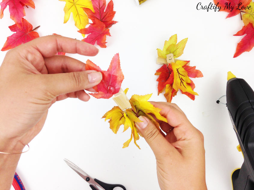 giving the clothespin autumn fairy a fall leaves hat or hairdo is pretty simple