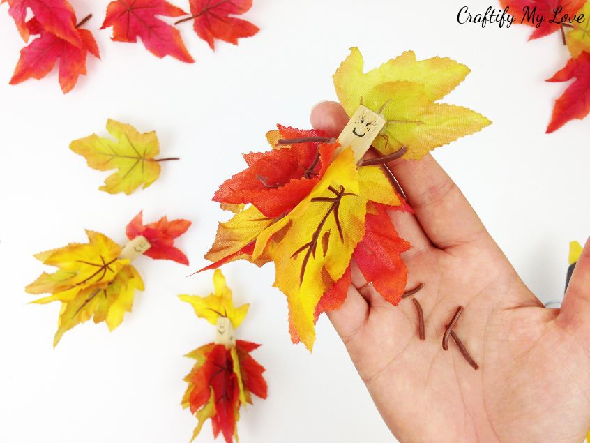 recycle those clipped off fall leaf stems into little arms for your autumn fairy