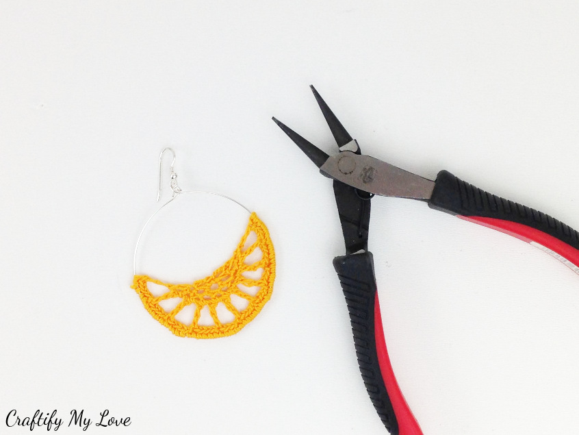 Add earring hooks to your crocheted hoop earrings that are obviously super boho style