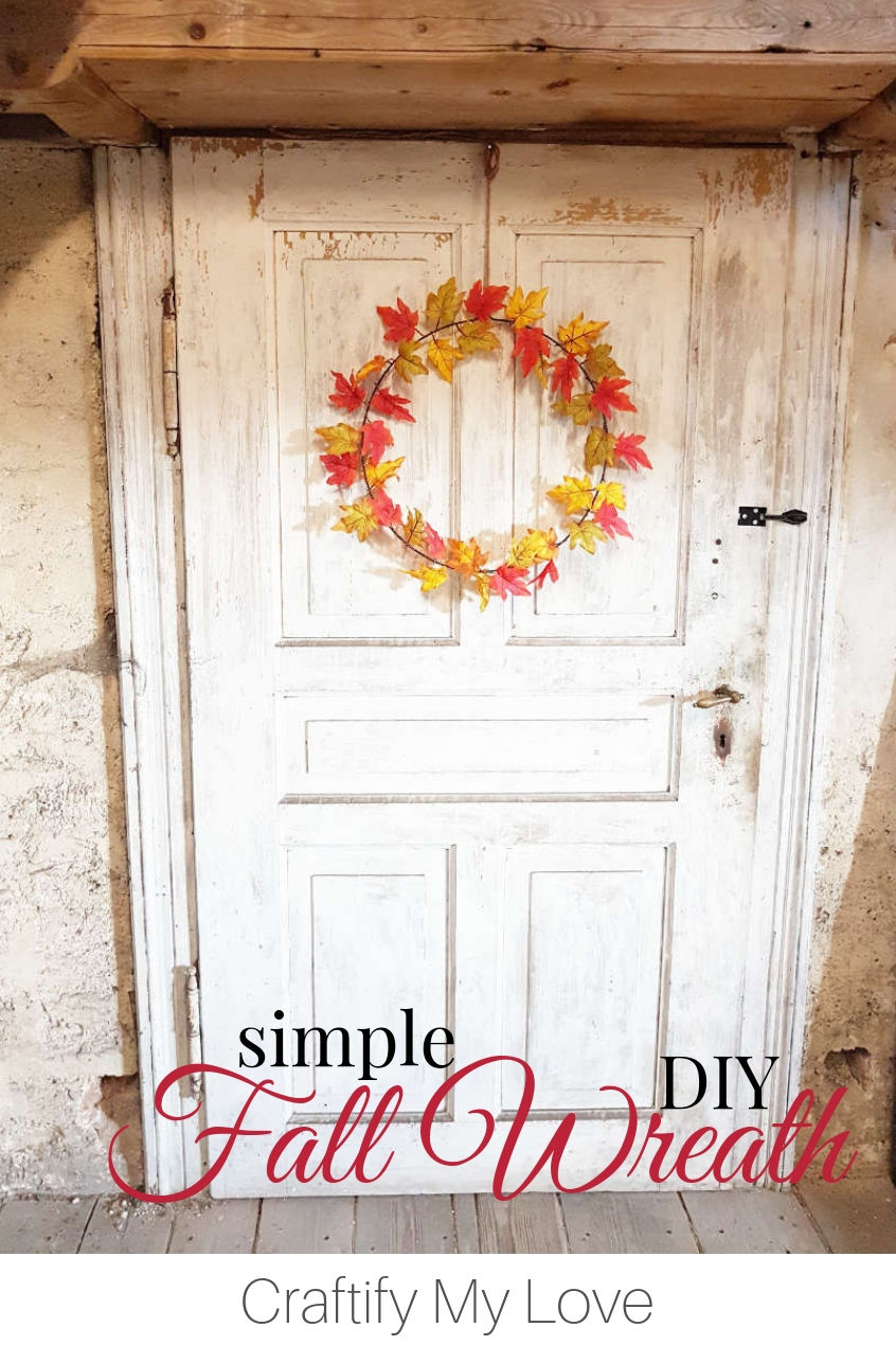 Simple fall wreath DIY from single faux fall leaves, gold wire, and an upcycled metal hoop. Click for detailed step-by-step instructions including video tutorial. #craftifymylove #fallwreath #diywreath #homedecor #frugalcrafts #upcyclingDIY