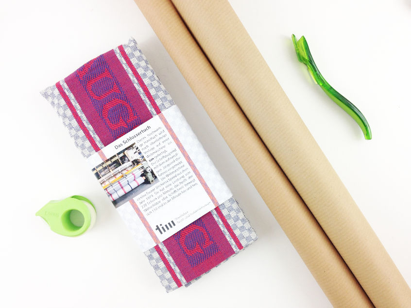 what you need to wrap a gift - gift wrapping paper, scotch gift wrap cutter, tape