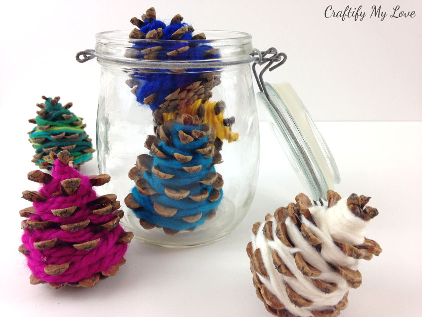 Christmas trees in a jar: Frugal home decor nature craft using pine cones and happy colourful yarn leftovers