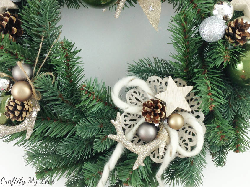 Close up of my sparkly deer antlers felt flower raw wool bow Christmas wreath