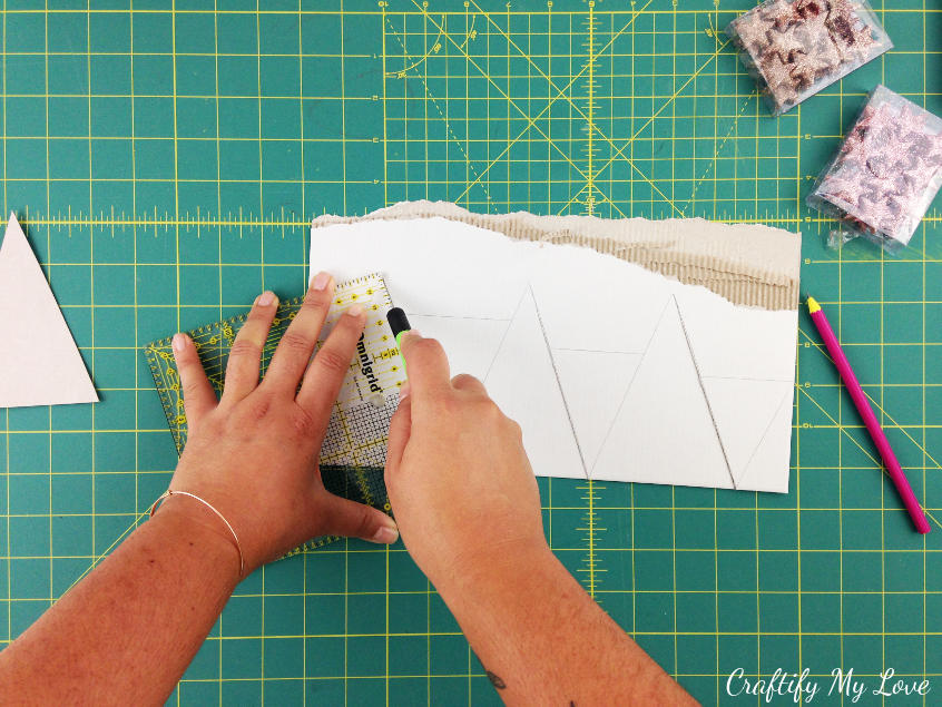 Cut out triangles of different sizes for a paper Christmas tree 10 minute craft