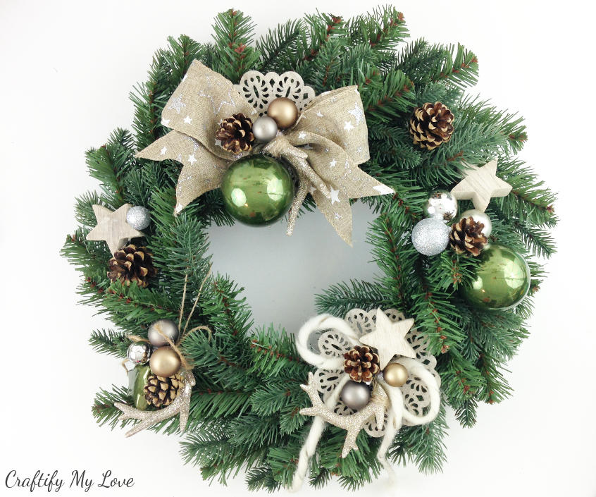 DIY deer winter wreath with antlers burlap pine cones and sparkle