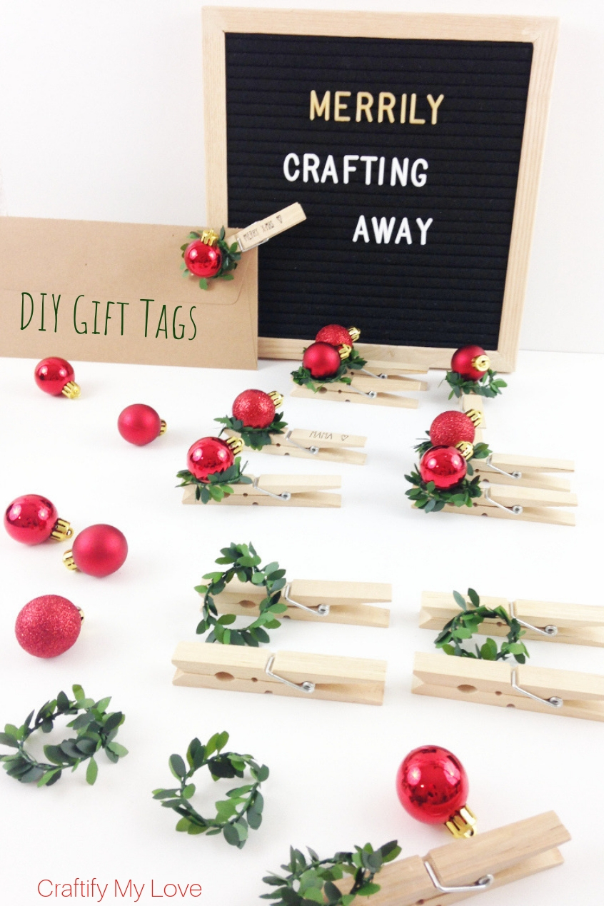 DIY Gift tags from clothespins, faux bow, and Christmas balls. Click to learn how easy they are made. #craftifymylove #DIYgifttags #greenandred #Christmas #clothespincraft
