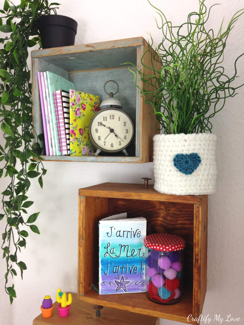 DIY a crocheted flower pot to bring some hygge elements into your home decor. Shelves from drawers and free water color printable