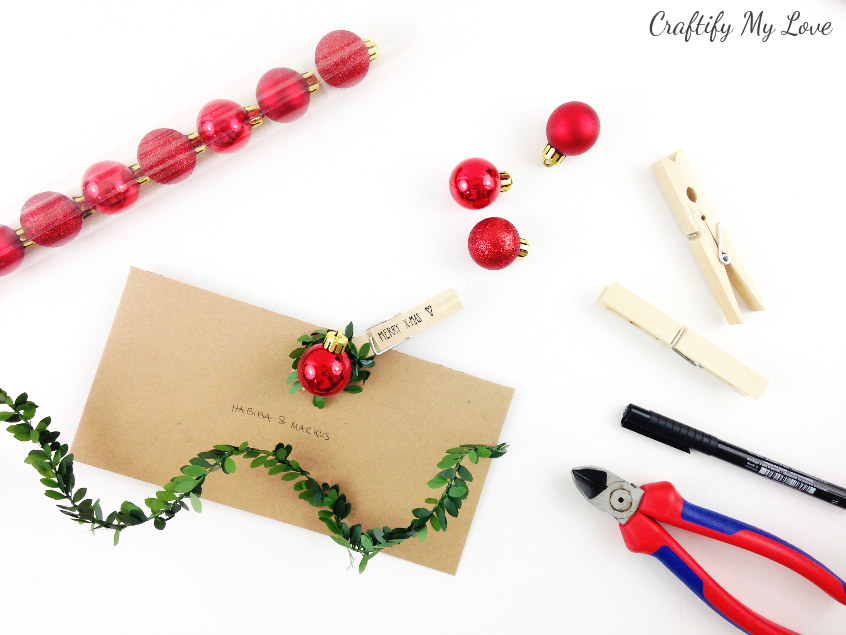 Supplies to make traditional red&green Christmas ball gift tags