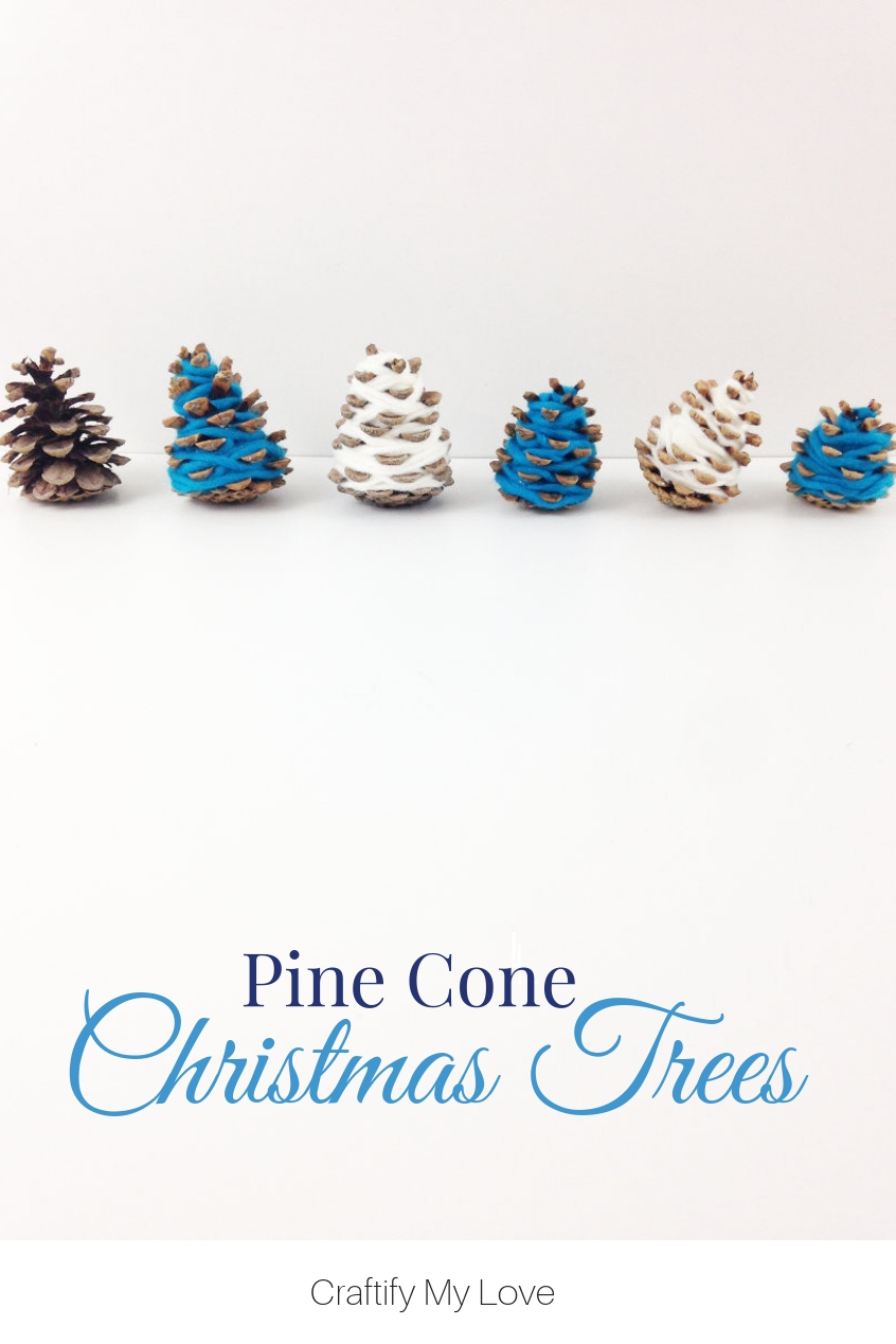 All you need for this Hygge Home Decor for Christas are yarn scraps and pine cones. Teal and white are perfect for a coastal home decor. #craftifymylove #coastaldecor #Christmasdecor #quickandeasy #diy #merryandbright