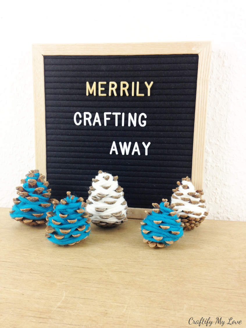 merrily crafting away making DIY Christmas decor nature crafts