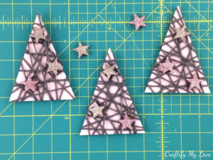 Mixed-media Christmas trees from upcycled shoe box, yarn, and glitter stars