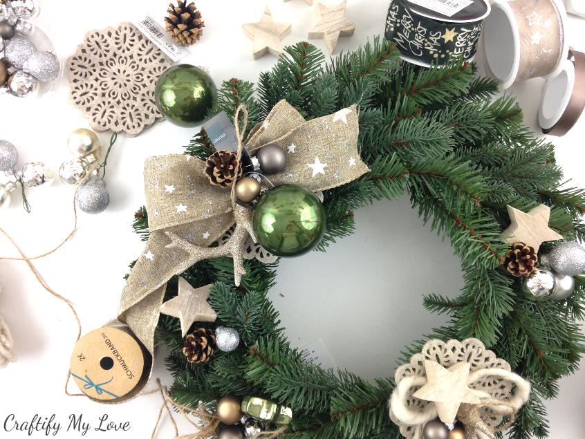 pre-arrange individual decor elements to get started on your design for a unique DIY deer winter wreath