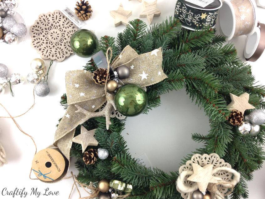 pre-arrange individual decor elements to get started on your design for a unique DIY deer winter wreath