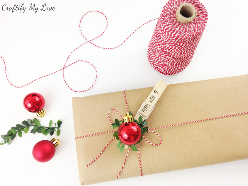 Pretty presents: Git wrapping idea for Christmas using basic brown paper and a traditional red and green color scheme in the embellishments
