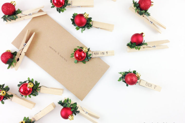 Upcycled clothespins DIY Christmas gift tags that can be easily personalised and are reusable on your pin board