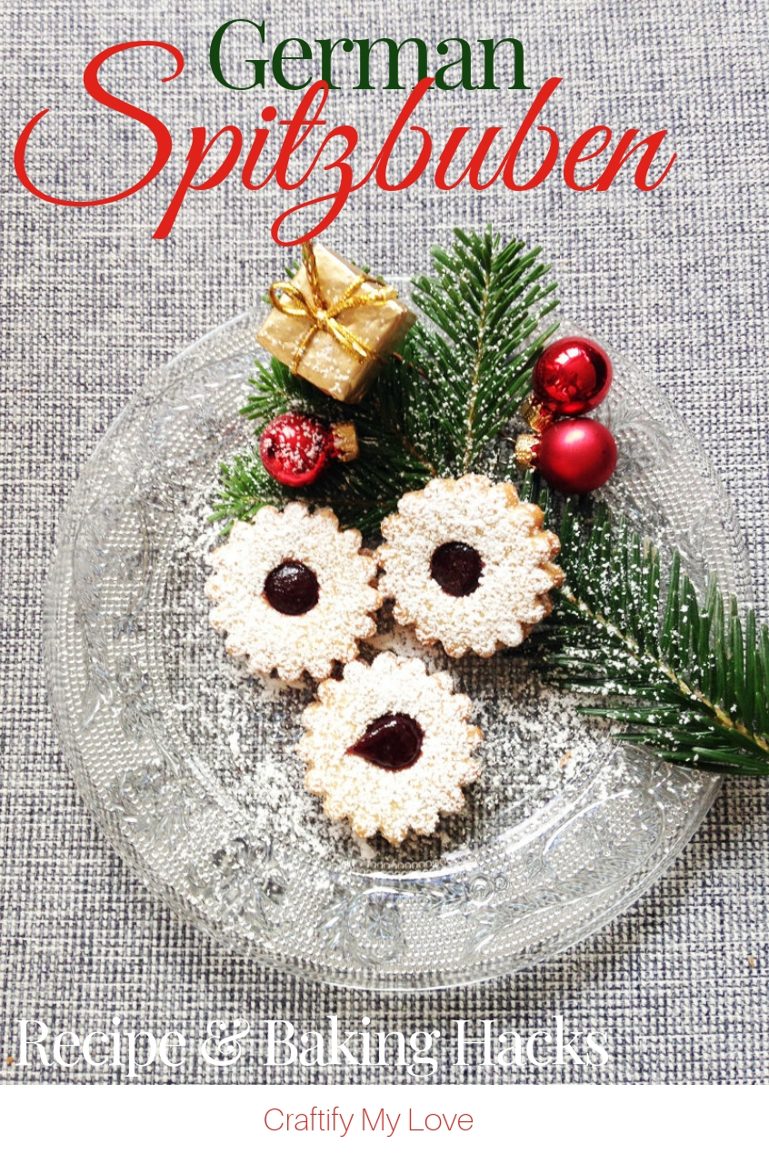 Spitzbuben, my favourite German Christmas Cookies ever! Click for the recipe and detailed step-by-step directions on how to make the dough, bake, and decorate them. BONUS: Nifty kitchen hacks for baking. #craftifymylove #Christmascookies #GermanChristmasbakery #kitchenhacks #recipe #sweettreats
