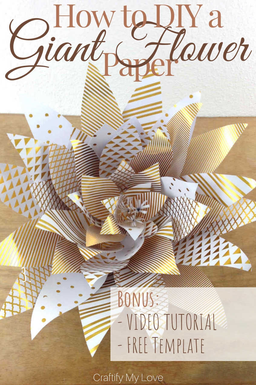 Learn how to DIY a giant paper flowers from scrapbook paper today. They make for awesome photo backdrop and easy DIY decor for weddings, birthdays, and baby showers. They look rather complex, but they are very simple to make. Click for a step-by-step photo and video tutorial and FREE template! #craftifymylove #giantpaperflower #howtomakeagiantpaperflower #weddingdecor #babyshower #DIYdecor #birthdayparty #whiteandgold #freetemplate