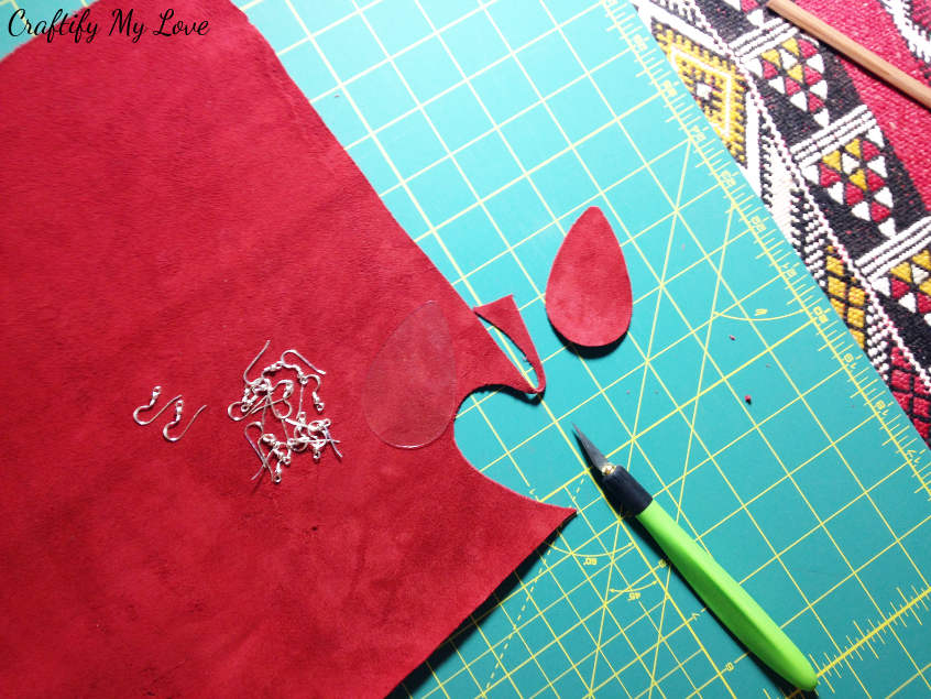 Cut out the teardrop shape from red velvet using an x-acto knife to DIY earrings