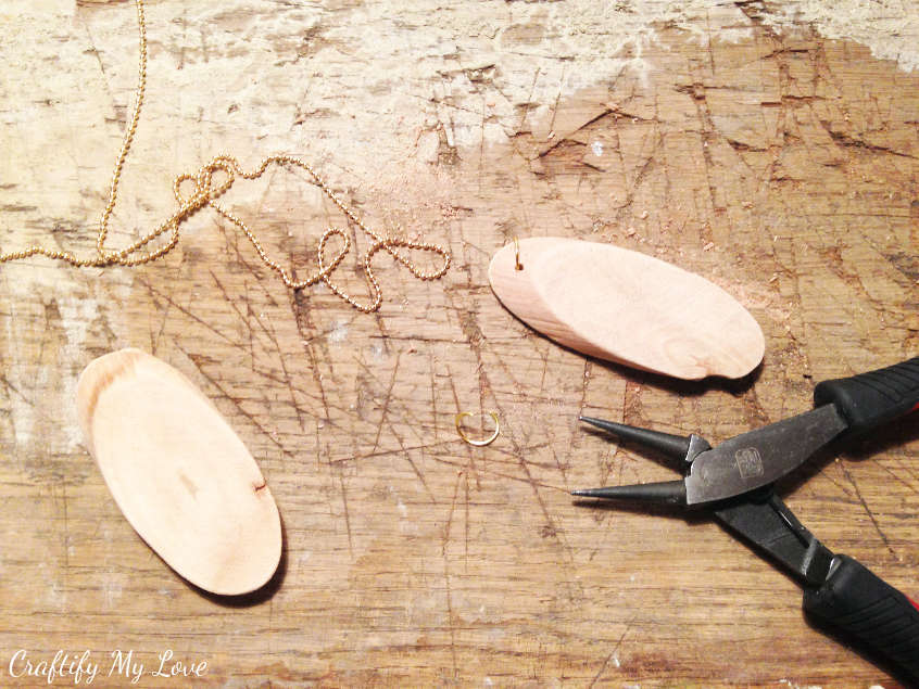 Adding the hanger to your wood slice diy jewelry pendant or key ring