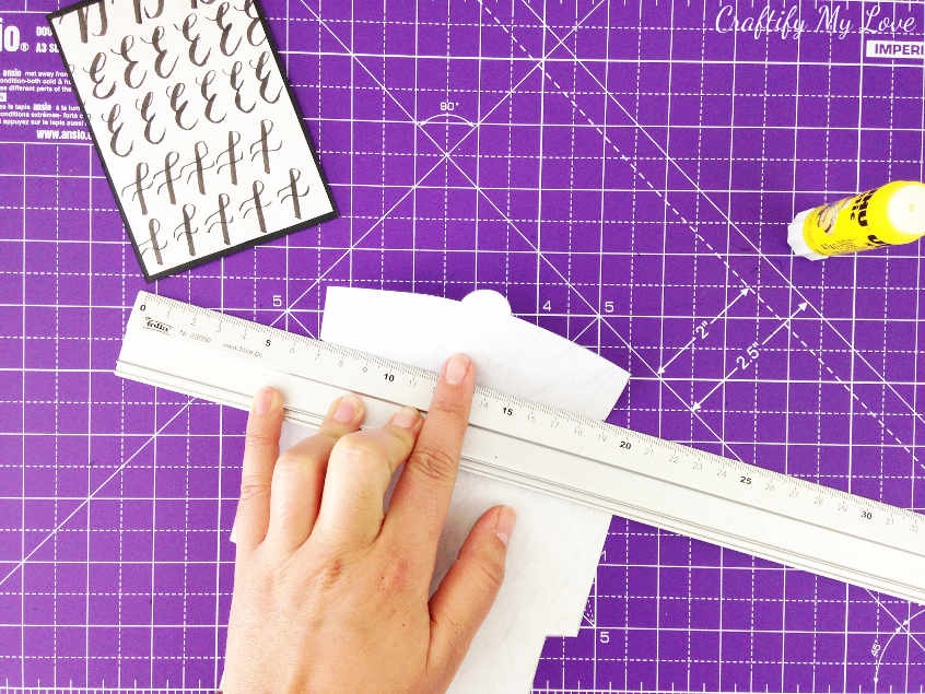 bend the edges of DIY mini envelope with a ruler