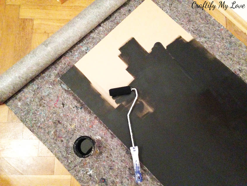 Paint the plywood board with chalk board paint. For best results use a foam roller