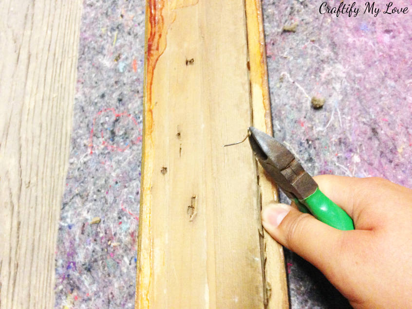 prepare the antique picture frame by cleaning it and removing old nails to DIY an upcycled chalk board