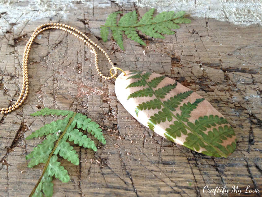 pressed and dried fern wood disc pendant for diy jewelry - a frugal dollar store craft