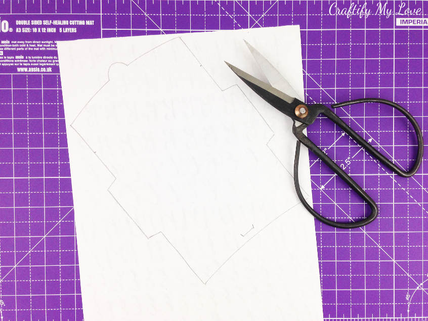 trace and cut the outline of free envelope template onto back of hand lettering practice sheet