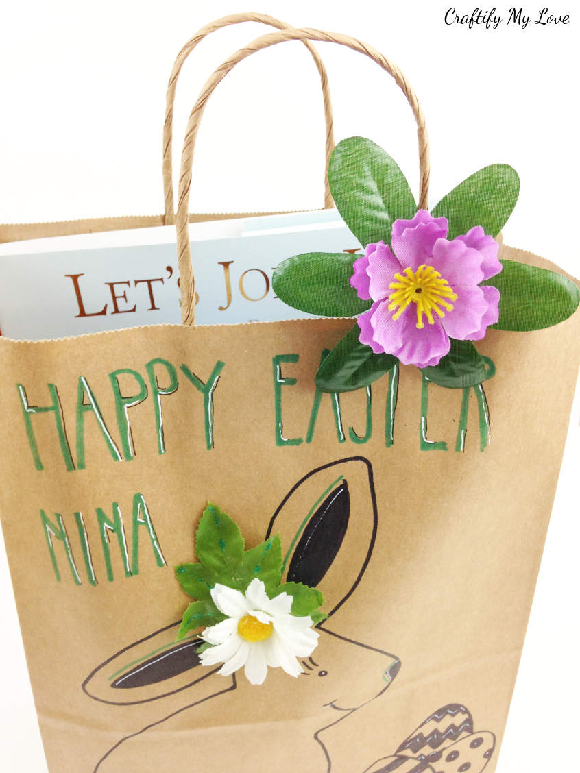 DIY Easter gift bag recycled brown paper bag with flower clip #craftifymylove #Easterbasket #recyclingcraft #upcycling #sharpiecraft #mixedmedia #giftwrapping #EasterDIY