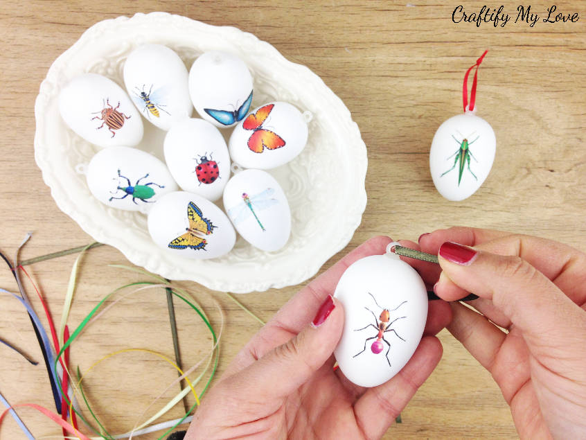 Learn how to get free craft supplies to add a beautiful satin ribbon to your decoupage Easter eggs sporting all sorts of cute little creepy crawlies