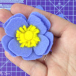 Felt Anemone flower DIY tutorial using a cutting machine includes free svg and free template