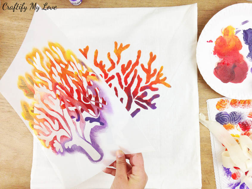 how to stencil a pillow ombre in a coral nautical design from yellow, orange, red, to purple