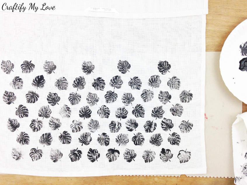 building up the pattern of monstera leaves DIY handstamped tea towel