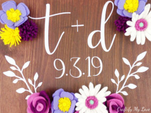 established wood sign makes for a unique wedding gift idea decorated with handmade felt flowers
