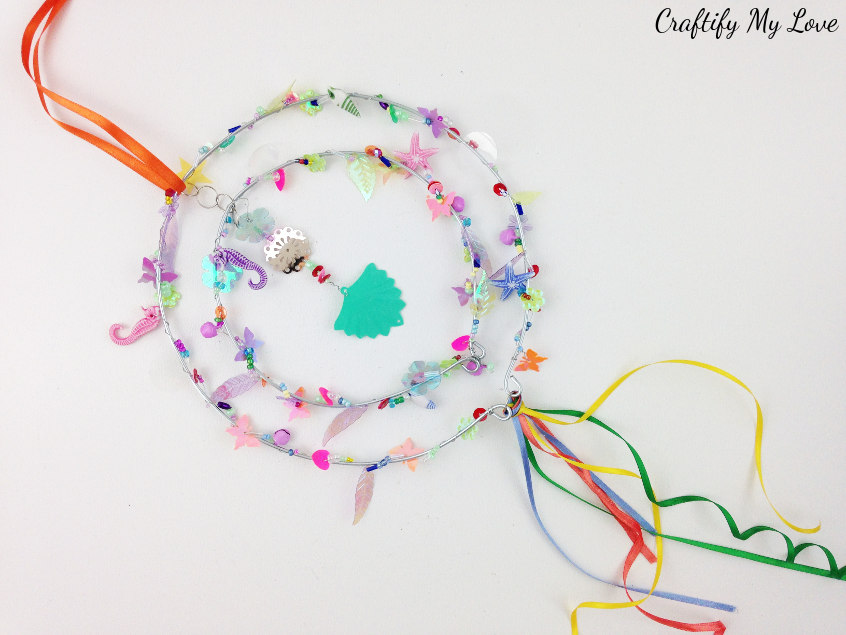 learn how to make a beaded suncatcher DIY to make your garden more colorful