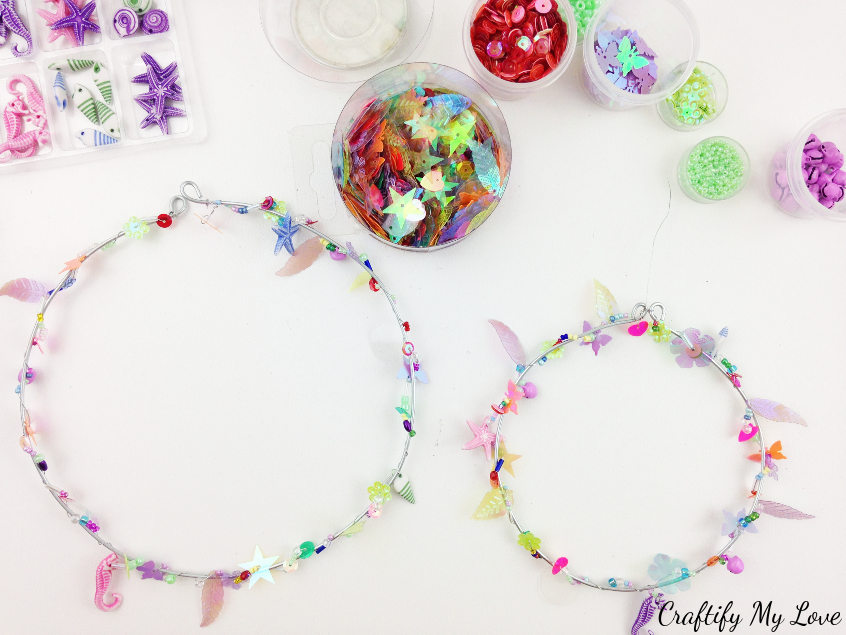 making the rings for a beaded rainbow hoop suncatcher mobile DIY