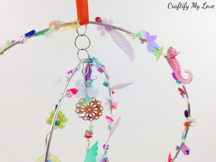 detailed look at sparkly beads and sequins suncatcher mobile DIY